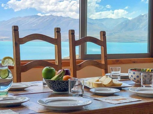 The Isolation Bay dining table with beautiful lake and mountain views.