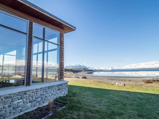 Isolation Bay house looks out over Lake Tekapo and the mountains of the Southern Alps.