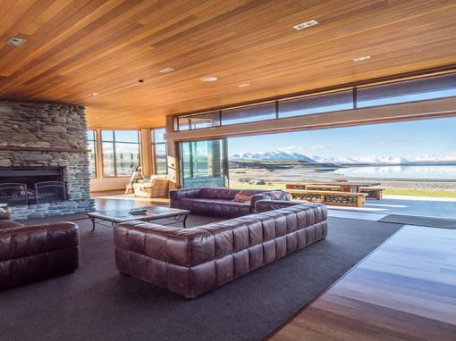 Isolation Bay lounge view of Lake Tekapo, outdoor seating and comfortable leather couches inside.